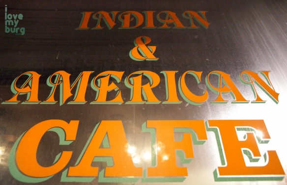 indian american cafe sign