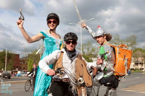 people dressed as bandits, on a bike