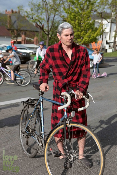 man dressed as old man with bike