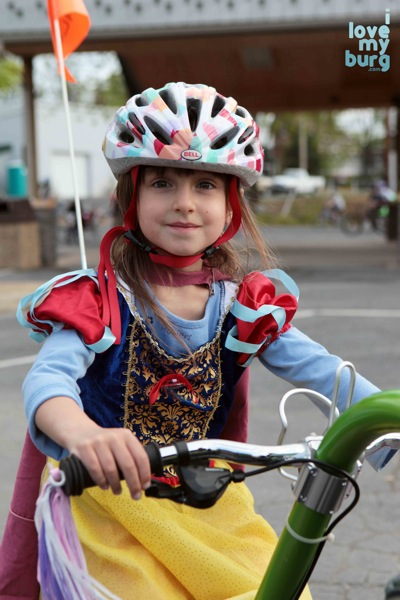 girl on bike in princess costume