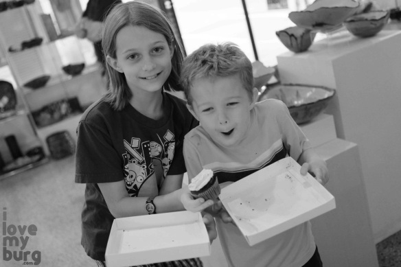 kids holding trays with cupcake