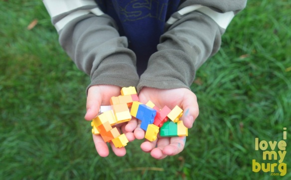 kids hands holding LEGOS