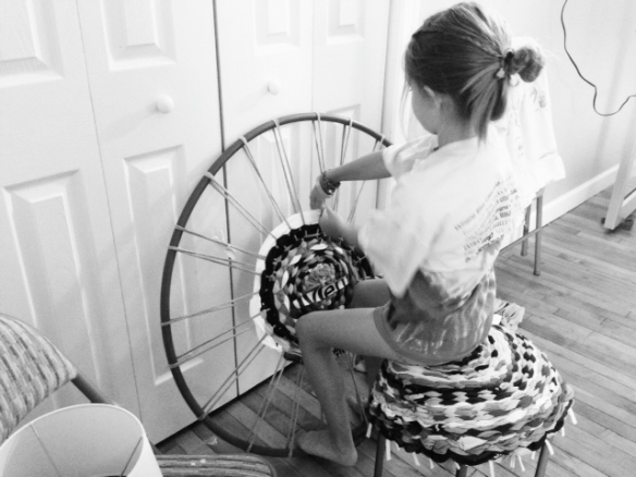girl weaving rug