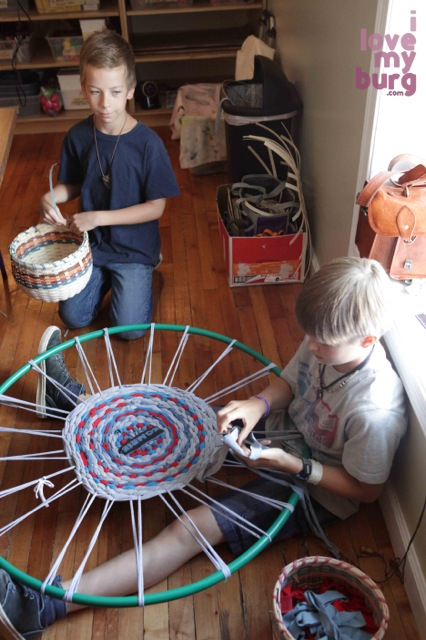 boy weaving rug