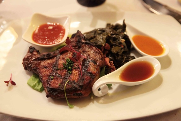plate with pork chop and collard greens