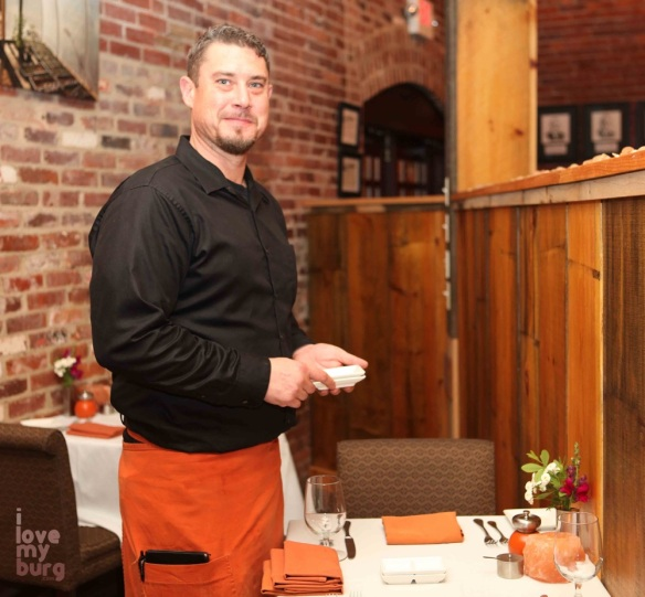 waiter in red apron