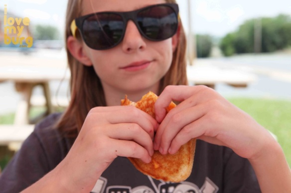 girl eating grilled cheese