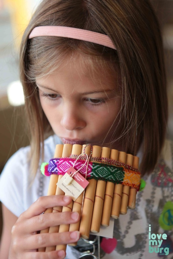 girl using flute