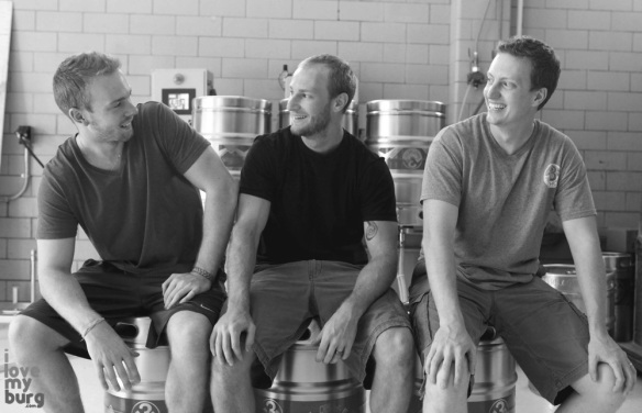 three men on kegs