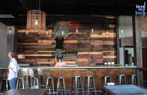 three brothers brewing wooden wall