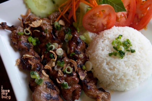 MARINATED GRILLED PORK (OR CHICKEN). grilled pork or chicken with carrots, tomato, cucumbers, jasmine rice, and clear sauce.