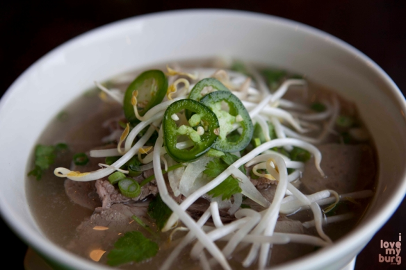 SOUP BOWLS. Rice noodles and beef, with basil, jalapeños, lime, and bean sprouts served on the side.